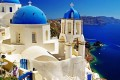 White and blue church domes and the breathtaking bay, Santorini island